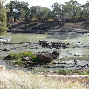 Stones forming fish traps in the river