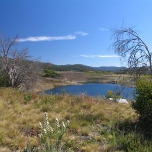 Rockfill on upstream face of dam